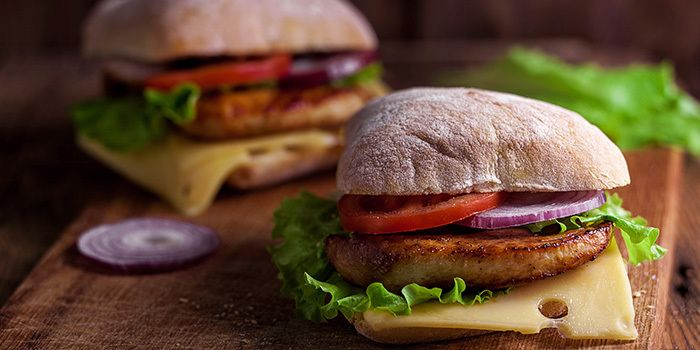 Make your own delicious chicken patties seasoned with garlic and spices and build them into a memorable sandwich with Swiss cheese and ciabatta rolls.