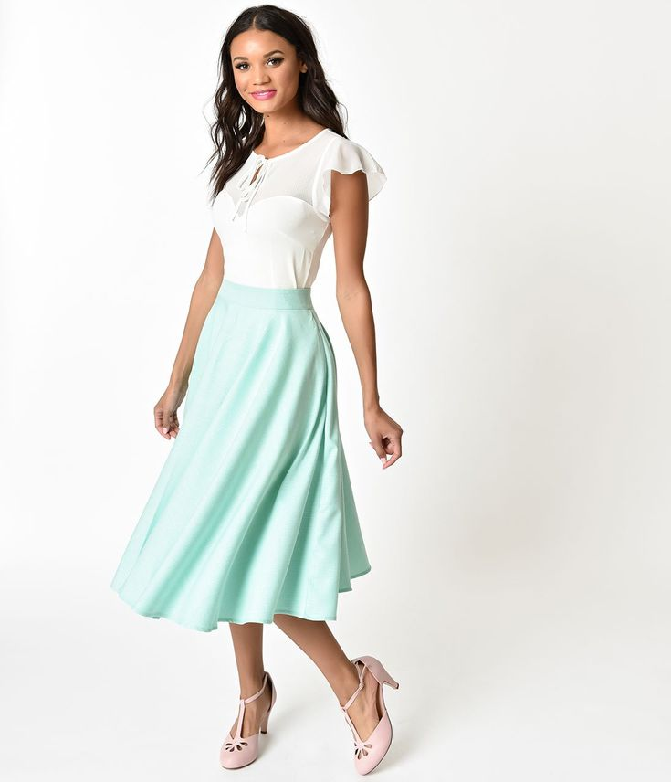 Vintage vibes like never before, babe! Sandy is a gorgeous light blue skirt from Voodoo Vixen, flawlessly tailored to be a true circle skirt. The flared style cinches around the waistline and falls beautifully on the body to give you an adorable mint colored silhouette. Featuring side pockets on the hips and a hidden back zipper for security, Sandy is a vintage inspired must have this season! Available in sizes S-2X while supplies last.
