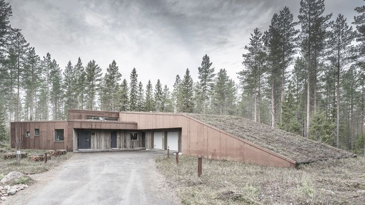Finnish practice Alt Arkkitehdit has covered a family home in northern Finland in weathering steel panels and greying spruce planks that help it to blend into its woodland setting.