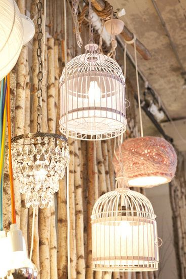 Birdcage Lighting display. Mix it up with a chandelier & a doily covered lamp. Love the mix. Birdcage ideas / repurpose