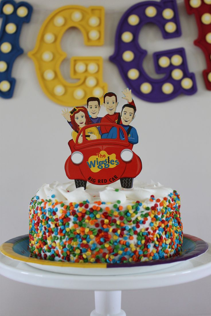 Bright sprinkles and a cake topper featuring The Wiggles elevates a cake with fluffy white frosting to an easy DIY masterpiece worthy of your little one's star-studded Wiggles birthday party celebration. (Photo credit: Jenny)