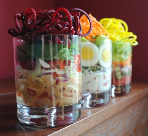 How to Make Individual Stacked Salads by thewholegang: The beauty of these salads is you can make them the day before, cover and store them in the refrigerator and bring the salads out as you sit down to your meal. Serve your salads on a plate.  When ready to eat, place the plate on top of the salad, hold tight, and then flip it over.  Slowly and gently pull the glass up and your salad will be completely dressed on your plate.  #Salad #Stack