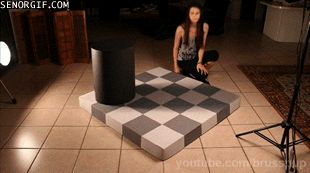 The gray tiles she's moving are actually the same color. | 22 Optical Illusion GIFs That Will Freak You Out