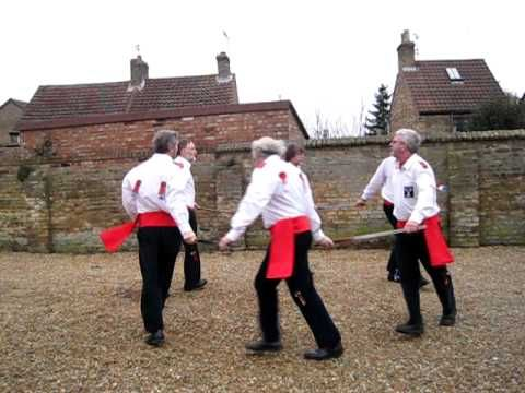 Southport Swords dancing on a cold and windy Saturday morning at Whittlesey Straw Bear festival 2011. Figure 6 is their own dance based on the rest of the North Skelton figures, and has been danced since 1969