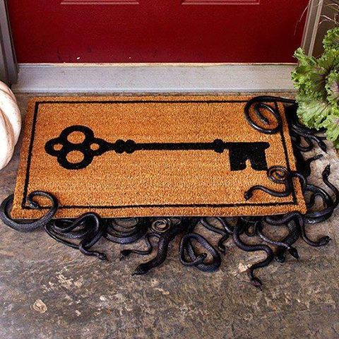To go w/ snake wreath..Snakes Under the Doormat: Spray-paint rubber snakes glossy black. Create various lengths of snakes by cutting them in two; arrange at the edge of a thick plastic-foam board and glue to the edges. Set the board underneath a doormat