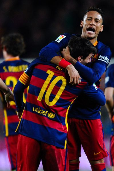 Lionel Messi (#10) of FC Barcelona celebrates with his team mate Neymar of FC Barcelona after scoring his team's first goal during the La Liga match between FC Barcelona and Sevilla FC at Camp Nou on February 28, 2016 in Barcelona
