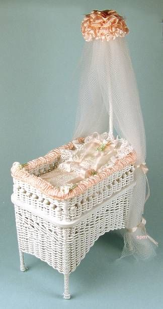 """Victorian wicker bassinet $132 Miniature  Silk mattress and pillow  Lace and silk trim  By Uncle Ciggie  3"""" deep, 1 3/4"""" wide, 6 1/4"""" tall"""