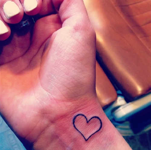<3#tattoo I have a similar heart on my left wrist. Mine is purple, representing my grandson's birthstone. It's on my pulse point. In bright light you can see the heartbeat!