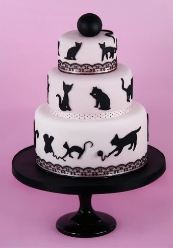 Catwalk - pink fondant cake decorated with fondant silhouettes of black cats (Cakes Haute Couture).