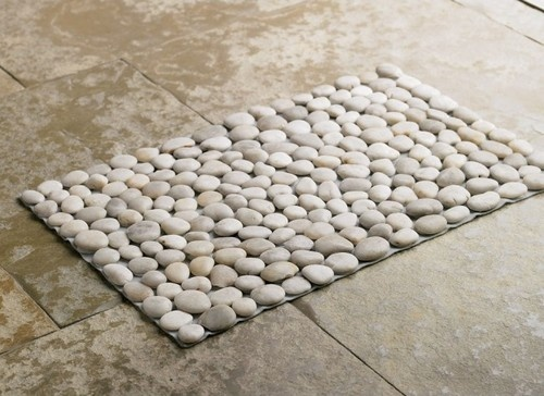 River rock bathmat. Diy with waterproof shelf liner, hot glue, and rocks from the dollar store store. Project total = less than $5!