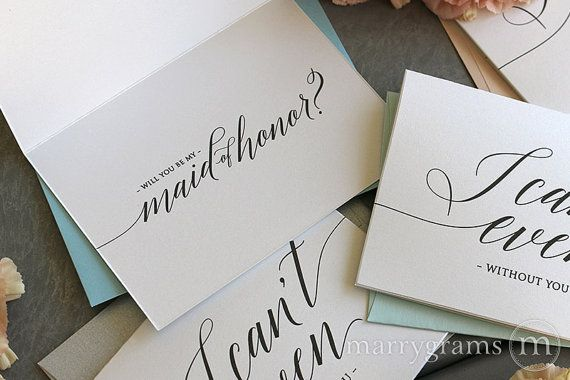 Marrygrams is the ORIGINAL wedding note card!®  These beautiful note cards are made with high quality white shimmer cardstock and dark grey text. A chic and stylish way to ask your best girls! Front of card states I cant even without you in a handwritten script. Inside of card reads will you be my bridesmaid? or title of your choice. The perfect pop of color is included with your choice of envelope. Blush, aqua and soft blue are shown above.  This listing is for a set of :: SIX (6) Bridal…