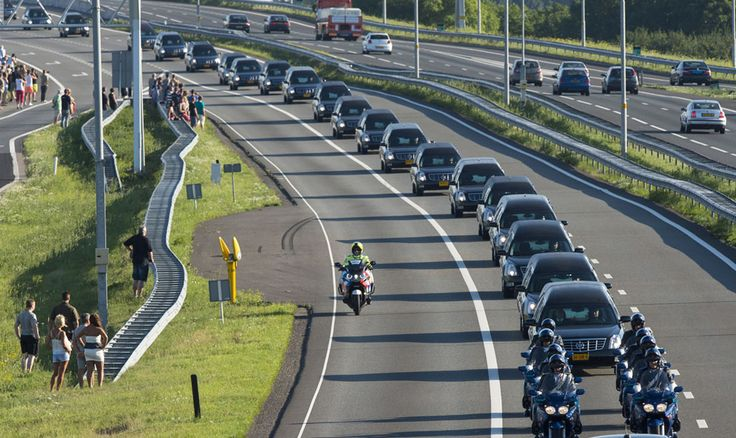 """""""A row of hearses carrying victims of the Malaysia Airlines flight MH17 plane disaster are escorted on highway A27 near Nieuwegein, Netherlands, by military police, on their way to be identified by forensic experts in Hilversum, on July 23, 2014."""" from Photos of the Week: 7/19-7/25 - In Focus - The Atlantic"""