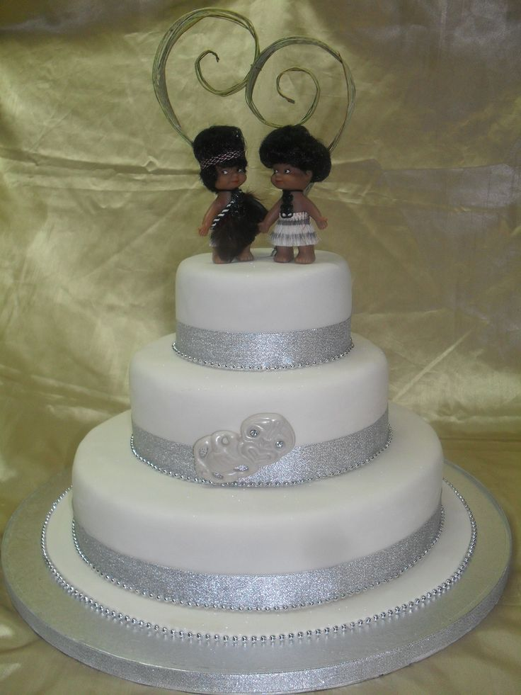 Maori themed wedding cake- celebrate your culture at your wedding. Beautiful cake decorated with a Maori Bride & Groom cake topper and special Tiki  www.frescofoods.co.nz Email: fresco@woosh.co.nz