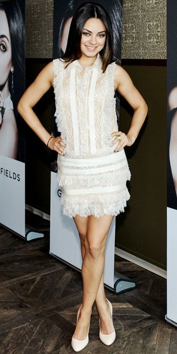 Mila Kunis wearing an Elie Saab white lace dress