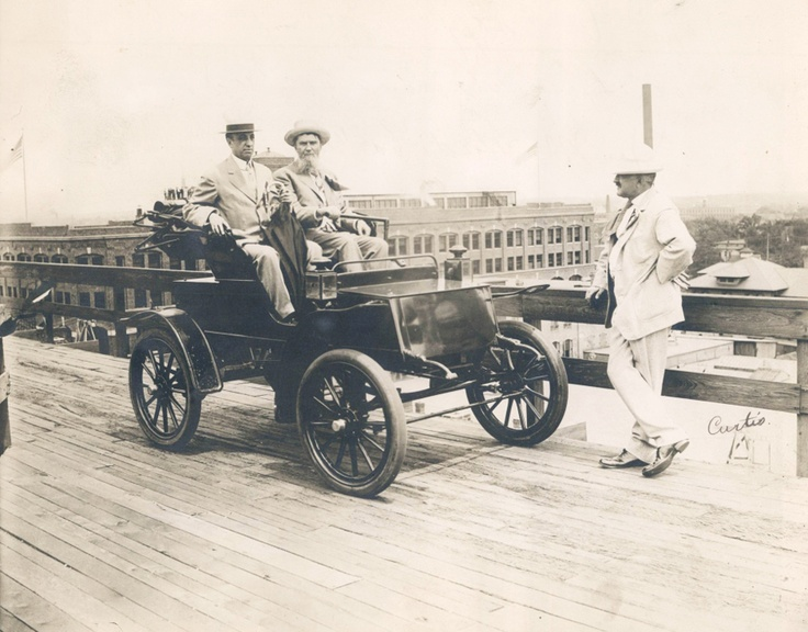 J. M. Studebaker and guest, taken on the roof of the Studebaker factory Sat June 26, 1909. Great photo of the early auto industry. Now how they got this car on the roof, I don't know.