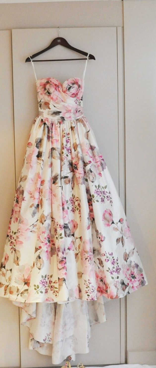 Although this is a vintage prom dress, I would wear a dress like it to work with a cardigan because of it's pretty florals and pink