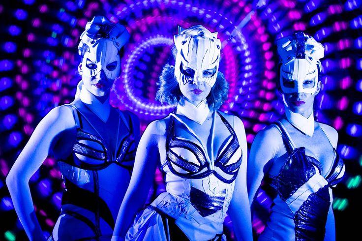 Dancers in UV light - girls from Crystal Light Show. http://antaagni.com/crystal-light-show/