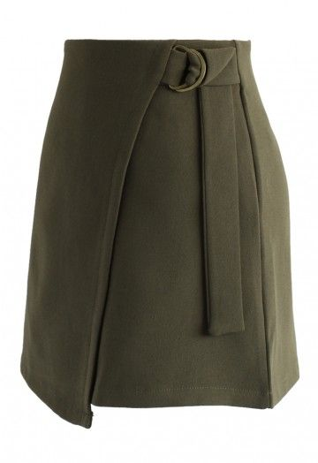 Schoolgirl chic meets militarized bad-assery in this pretty chic flap skirt in a flavorful army green. The hue paired with the D-ring shaped belt make this mini a sassy ode to the '90s. - Asymmetric flap design - D-ring belt trimmed on waist - Concealed Back zip closure - Lined - 100% Polyester - Hand wash Size(cm)Length Waist XS       41.5    66  S        41.5    70    M        42.5    74    L         42.5    78    Size(inch)…