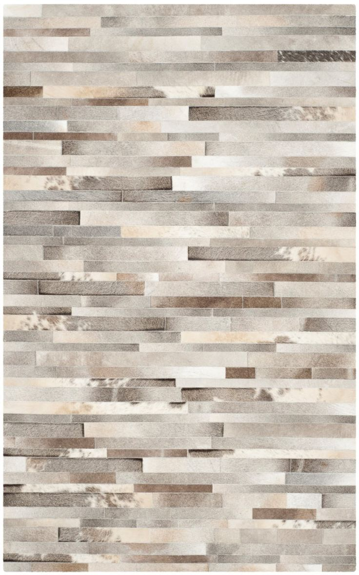 Fashion-forward and textural, Studio Leather rugs from Safavieh are crafted with the finest cowhides and leather. Designs in the collection range from classic square patchwork rugs to innovative compositions featuring appliqued geometric cutouts....