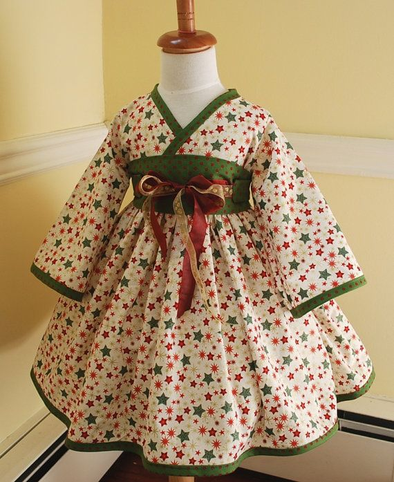 Adorable dress-not too fond of the fabric choice though...something more flowery would be better I think.