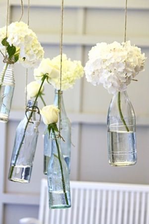 I love this for decoration around the reception, similar table centerpieces with one flower each different in a separate vase. Obsessed*