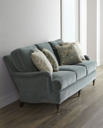 Kallita Sofa by Lee Industries at Horchow.  Stunning choice, great blue color to tie-in the rug, durable fabric (poly/rayon blend), would be easy to clean.  But definitely a splurge.