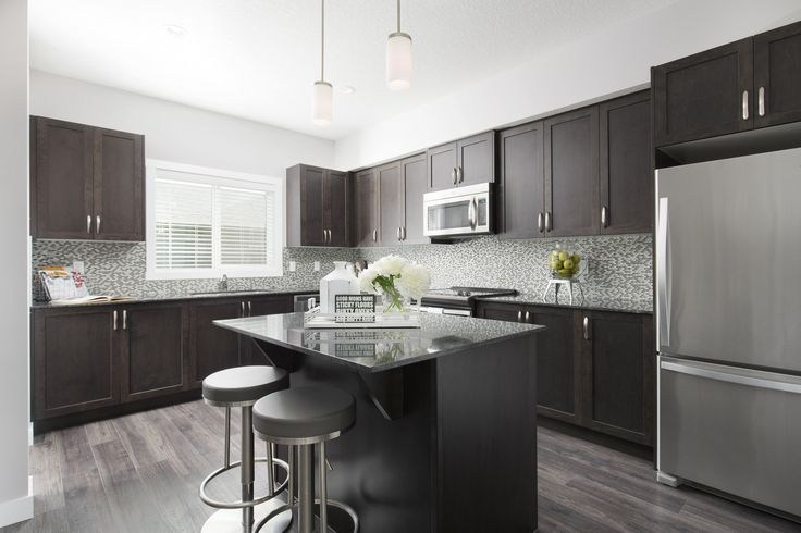 L-shaped kitchen with central island and stainless steel appliances #kitchen