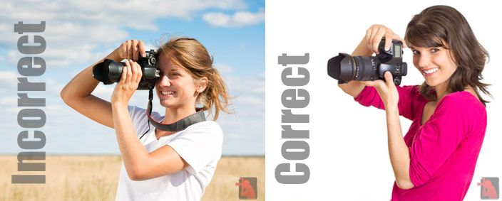 How to hold a DSLR camera