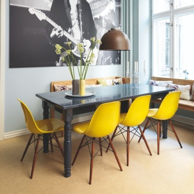 Yellow eames chairs and grey table - great combo