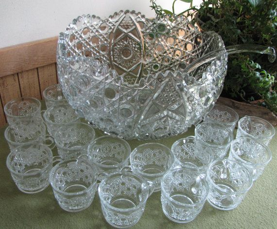 This cut glass 1970's punch bowl set is a complete 20 piece set that includes the glass ladle. There are 18 glasses. The set is in very good vintage condition with no chips or cracks in the bowl, ladle or any of the glasses. The punch bowl is very heavy and is 8.5 inches tall and 12.5 inches in diameter. There are 18 cups and they measure 2 inches tall and 3 inches in diameter. The glass ladle about 13 inches long and 4 inches in diameter at the scoop. I have a picture of the original box it…