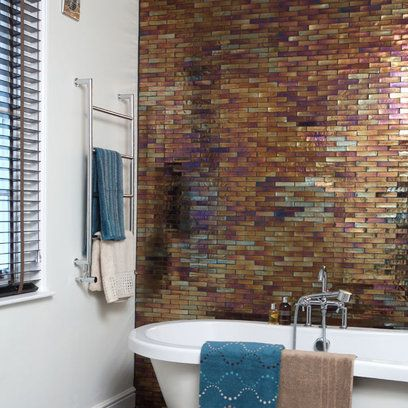 Love this minimal design with high impact - freestanding bath and a feature wall  of tiles