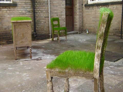 Just because all you have is a concrete slab doesn't mean you can't plant some grass...:)