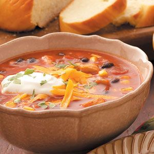 Mexican Chicken Soup  1-1/2 cups with 1 tablespoon each cheese and sour cream and 1 teaspoon cilantro equals 345 calories, 7 g fat (3 g saturated fat), 72 mg cholesterol, 1,315 mg sodium, 34 g carbohydrate, 7 g fiber, 31 g protein. Diabetic Exchanges: 4 lean meat, 2 vegetable, 1-1/2 starch, 1/2 fat.