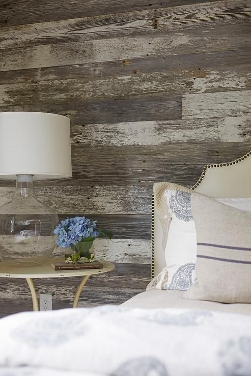 Rustic cottage bedroom with barn board wall