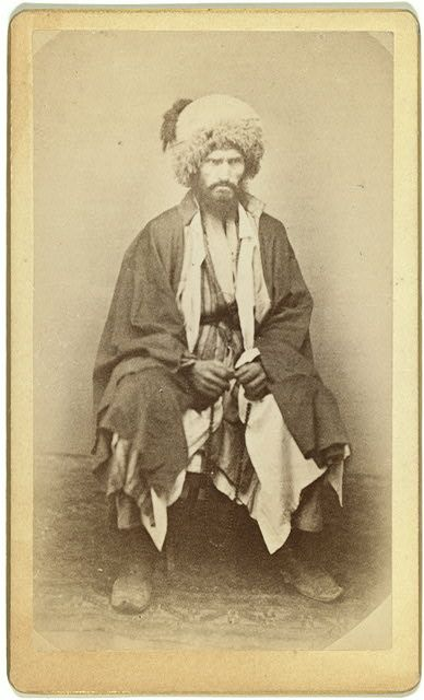 [Full-length portrait of man, seated, facing front]
