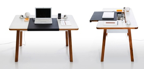 StudioDesk --a streamlined work space that promises to banish tech-related clutter. It's got a built-in storage compartment under the sliding desktop surface, where you can stash any power strips, AC adapters, USB hubs, and external hard drives. Cables tuck neatly into an elongated slot across the top.