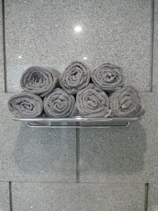Neatly rolled towels in my bathroom