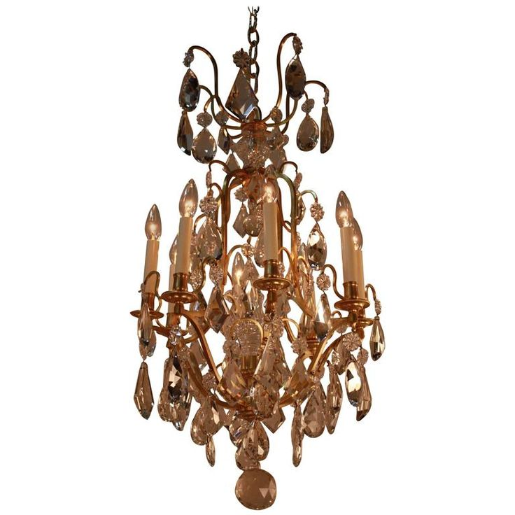 Elegant Crystal and Bronze Chandelier   From a unique collection of antique and modern chandeliers and pendants at https://www.1stdibs.com/furniture/lighting/chandeliers-pendant-lights/