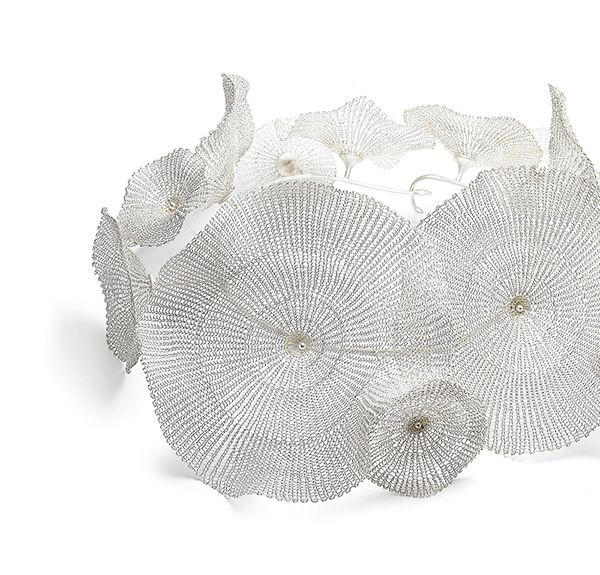 Blooming, conceptual jewelry made by Sowon Joo (Korea).
