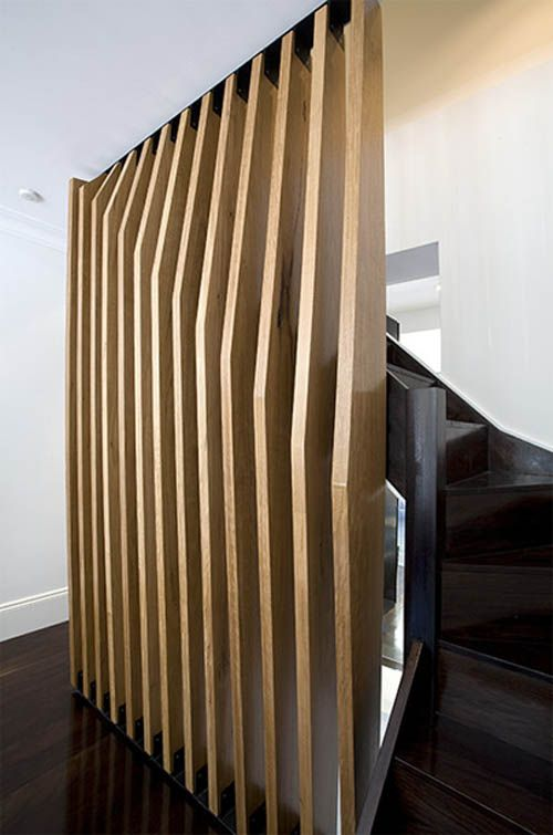 Bent wood screen at stairs. Q house. MCK Architects.