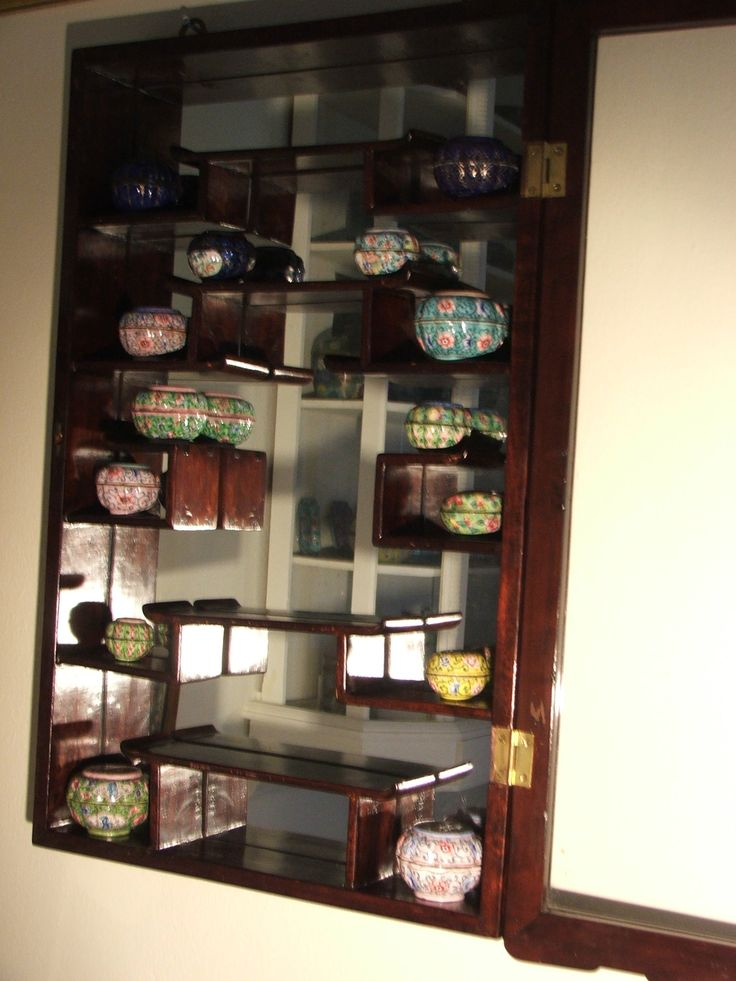 Chinese scent bottle cabinet with objets enamel work of all sorts