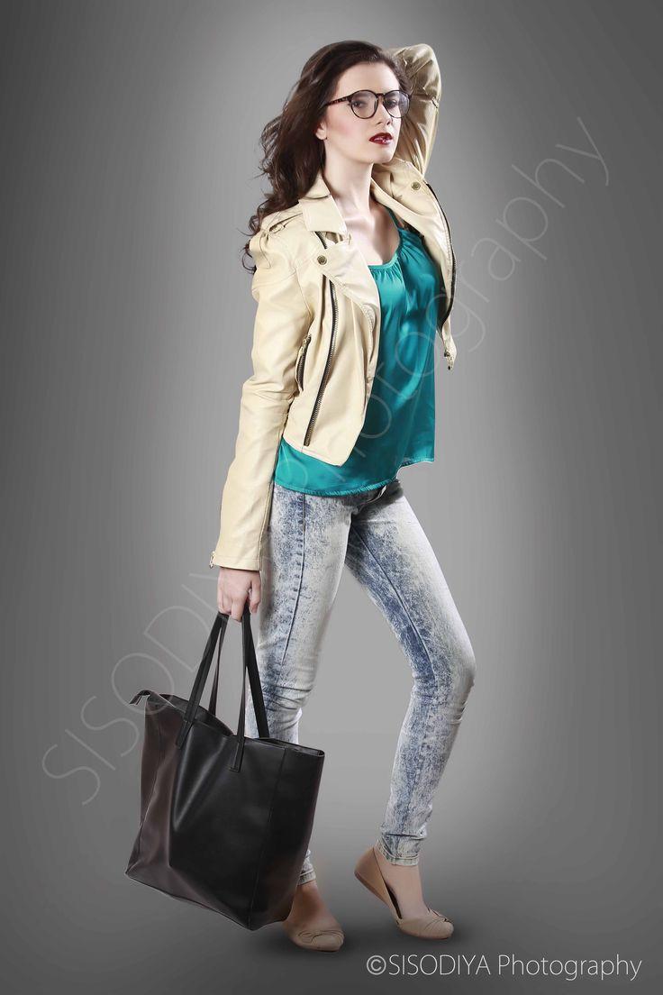 Fashion photography using lather bag & Jacket in sexy pose by Sisodiya Photography... Model - Cleo Larroryd