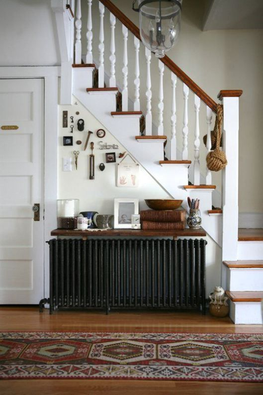 This is a simple idea in a hallway. A shelf over an old cast-iron radiator
