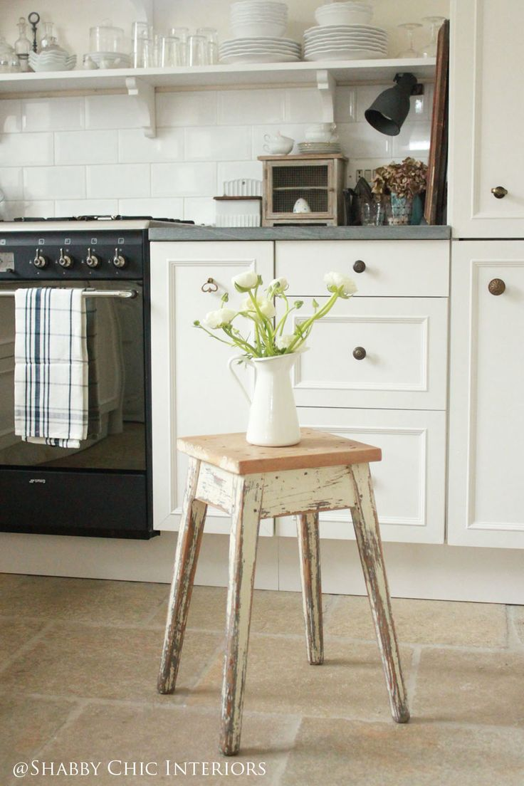 DIY:  How To Restyle Plain Cabinets with Hardware and Trim Moulding  - using wood, glue and collected hardware, plain, stock cabinets were given a whole new look. Shabby Chic Interiors