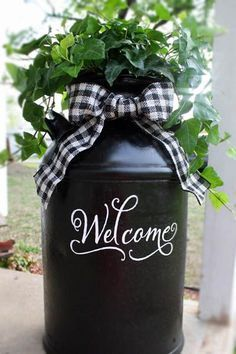 Look what you can do with a milk can, paint, & vinyl from myvinyldirect.com Too cute for the front porch & easy!