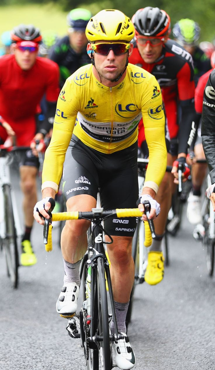 #MarkCavendish of Great Britain and Team Dimension Data wears the yellow leader jersey as he rides during stage two of the 2016 Tour de France from Saint-Lo to Cherbourg-Octeville on July 3, 2016 in Cherbourg, France.