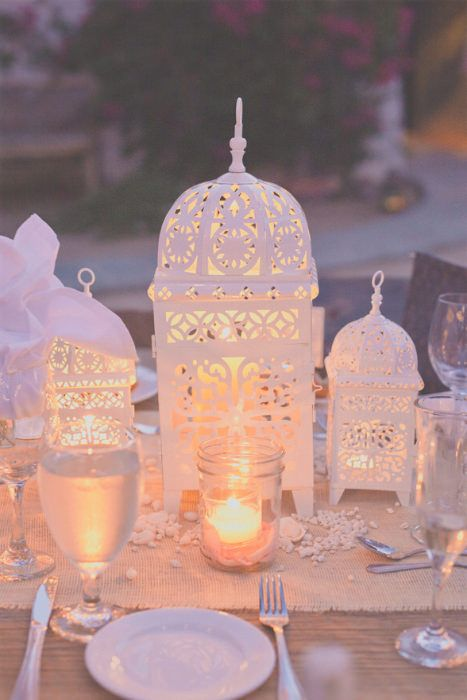 Moroccan glamour - white lantern centerpieces. Source: Hazelwood Photo #moroccandecor #lanterns
