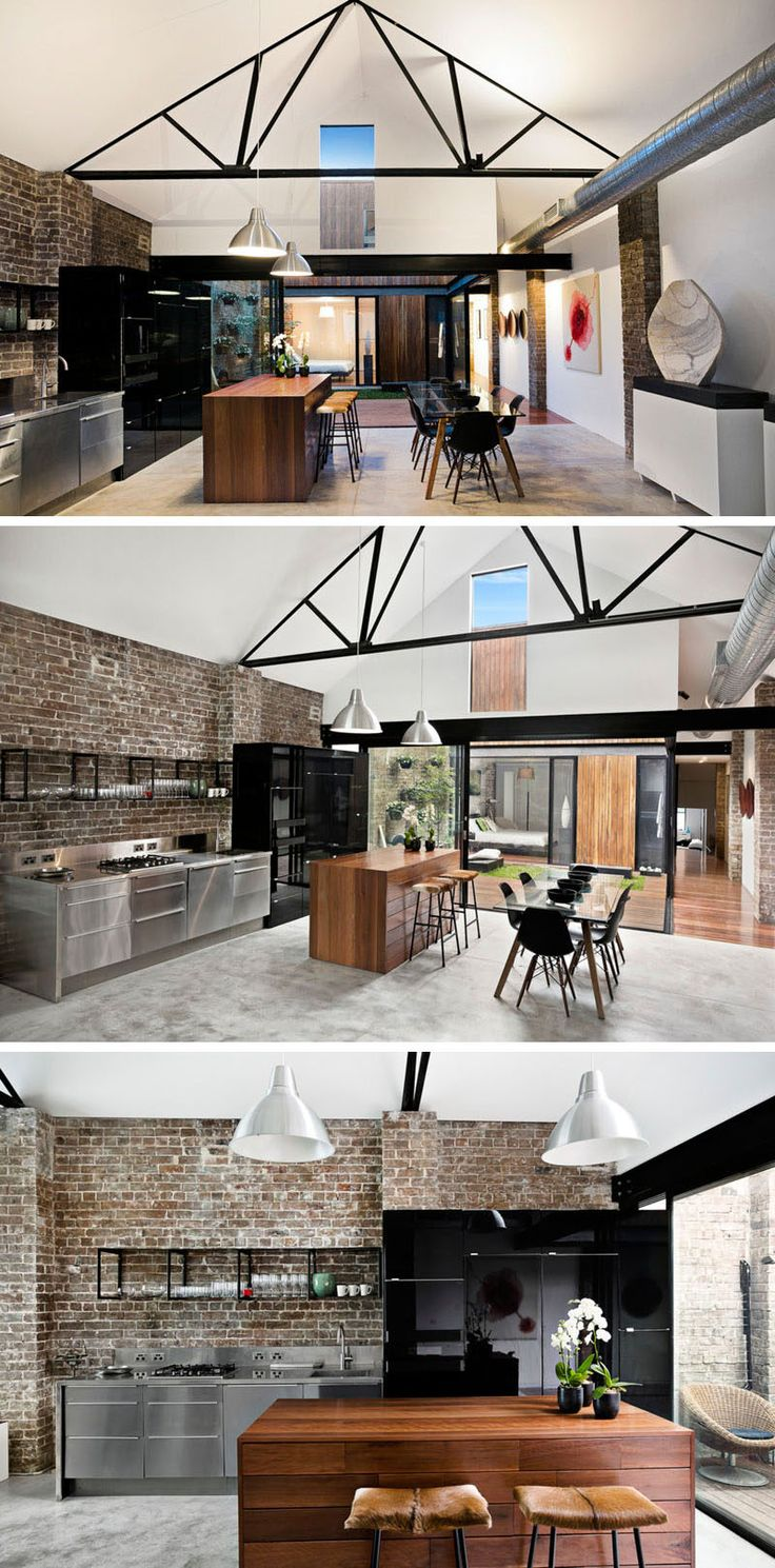 Vaulted white ceilings and with contrasting black frame work draws the eye upwards, and black cabinetry in the kitchen and black chairs around the dining table help to create a cohesive look.