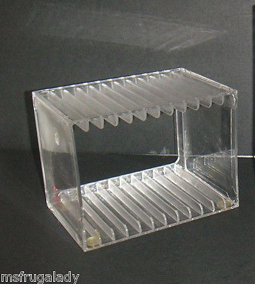 This CLEAR ACRYLIC CD JEWEL CASE RACK holds 12 Single Standard CD JEWEL CASES - Desk Storage Organizer Media RACK -   Unit has 4 RUBBER-BOTTOM TABLE-PROTECTORS.