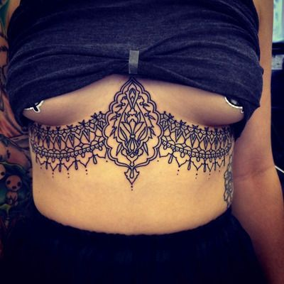 Love this sternum/waistline tattoo. When I hit the lottery, I'm getting this.